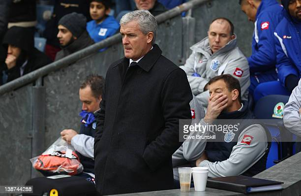 Queens Park Rangers manager Mark Hughes as the bench show their dejection during the Barclays Premier League match between Blackburn Rovers and...