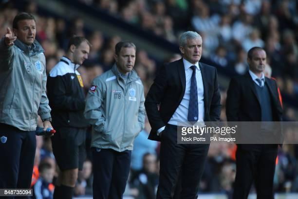 Queens Park Rangers manager Mark Hughes West Bromwich Albion manager Steve Clarke Queens Park Rangers assistant manager Mark Bowen Queens Park...