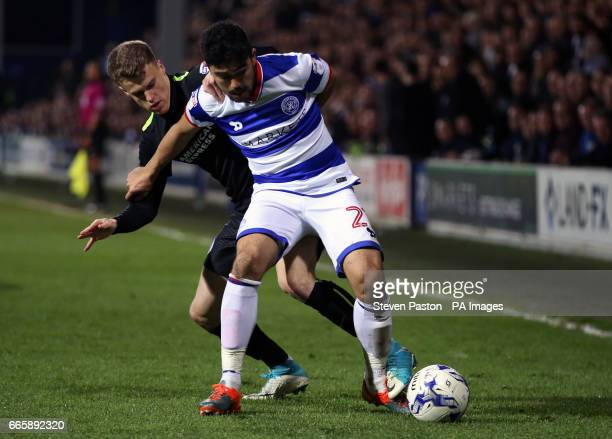 Queens Park Rangers' Massimo Luongo and Brighton Hove Albion's Solly March battle for the ball during the Sky Bet Championship match at Loftus Road...