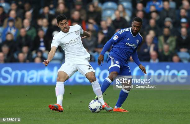 Queens Park Rangers' Massimo Luongo and Cardiff City's Junior Hoilett during the Sky Bet Championship match between Queens Park Rangers and Cardiff...