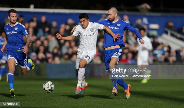 Queens Park Rangers' Massimo Luongo and Cardiff City's Matthew Connolly during the Sky Bet Championship match between Queens Park Rangers and Cardiff...