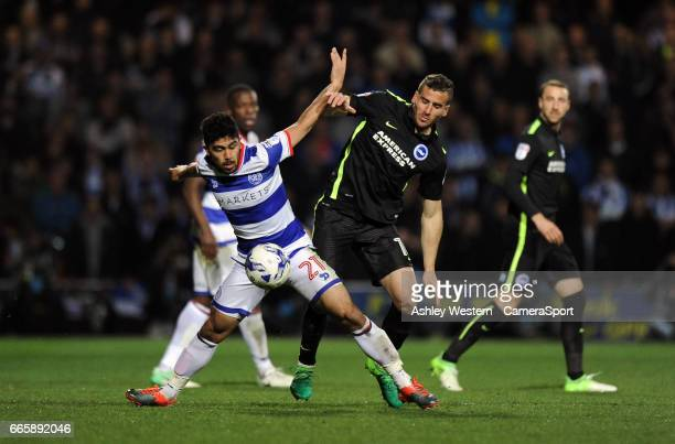 Queens Park Rangers' Massimo Luongo battles for possession with Brighton Hove Albion's Tomer Hemed during the Sky Bet Championship match between...
