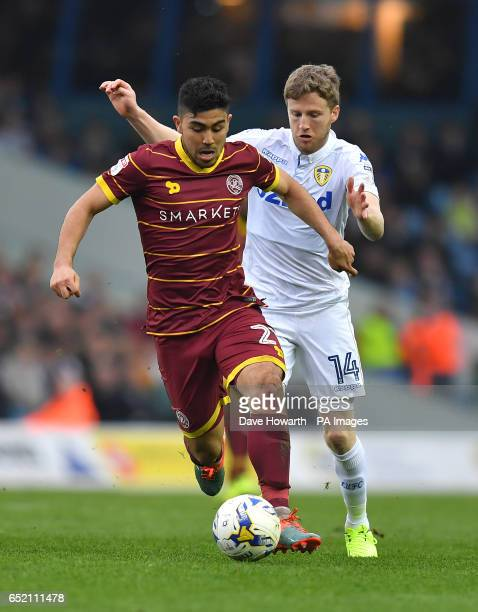 Queens Park Rangers' Massimo Luongo battles past Leeds United's Eunan O'Kane during the Sky Bet Championship match at Elland Road Leeds