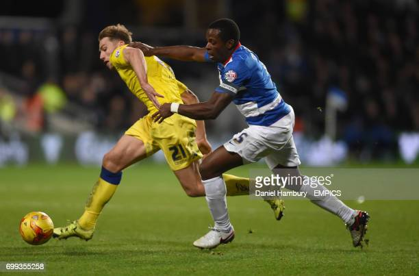Queens Park Rangers' Nedum Onouha tackles Leeds United's Charlie Taylor