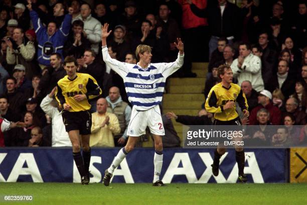 Queens Park Rangers' Peter Crouch appeals for a free kick after Arsenal's Tony Adams and Ray Parlour look uninterested