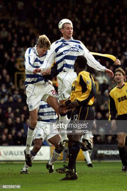 Queens Park Rangers' Peter Crouch jumps for the ball with team mate Karl Connolly watched by Arsenal's Lauren and Tony Adams