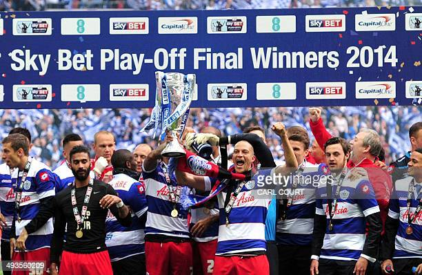 Queens Park Rangers players celebrate with the trophy after winning the English Championship Play Off final football match against Derby County at...