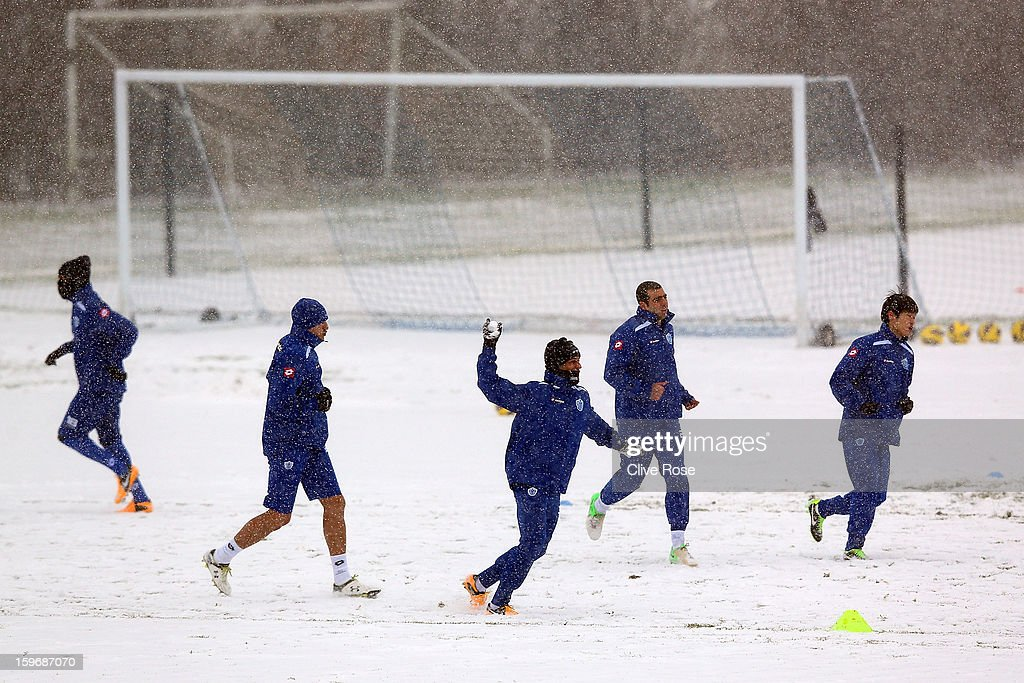 Queens Park Rangers players participate in a training session on January 18, 2013 in Harlington, England.