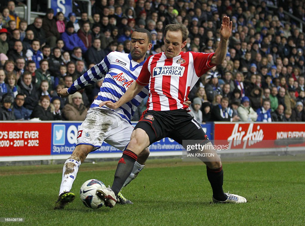 """Queens Park Rangers Portugese defender Jose Bosingwa (L) vies with Sunderland's Welsh midfielder David Vaughan (R) during the English Premier League football match between Queens Park Rangers and Sunderland at the Loftus Road Stadium in London on March 9, 2013. AFP PHOTO/IAN KINGTON USE. No use with unauthorized audio, video, data, fixture lists, club/league logos or """"live"""" services. Online in-match use limited to 45 images, no video emulation. No use in betting, games or single club/league/player publications"""