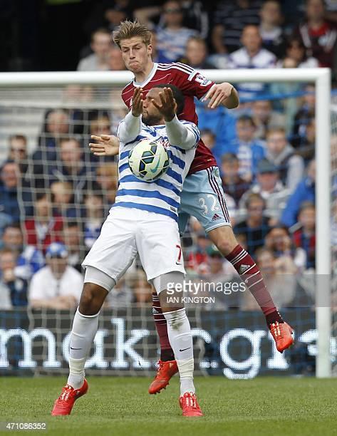 Queens Park Rangers Scottish midfielder Matt Phillips vies with West Ham United's English defender Reece Burke during the English Premier League...