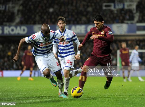 Queens Park Rangers' Stephane M'Bia and Manchester City's Sergio Aguero battle for the ball