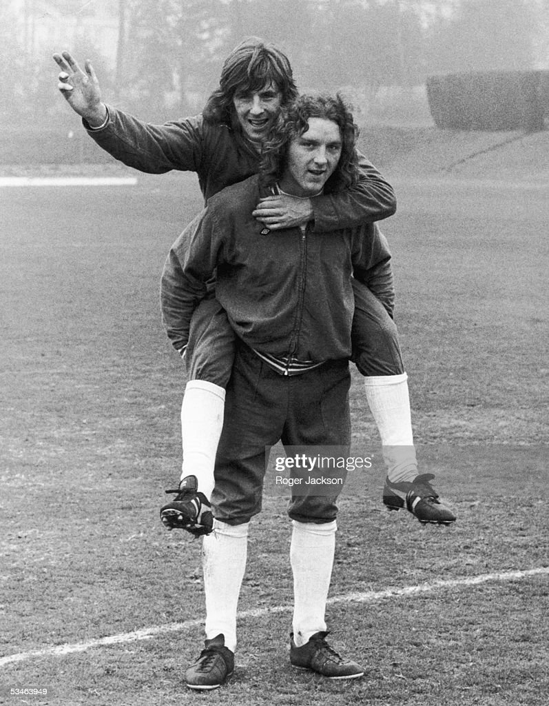 Queen's Park Rangers striker Stan Bowles rides Ipswich Town defender Kevin Beattie around the pitch at Roehampton, during training for the upcoming international against Portugal, 1st April 1974.