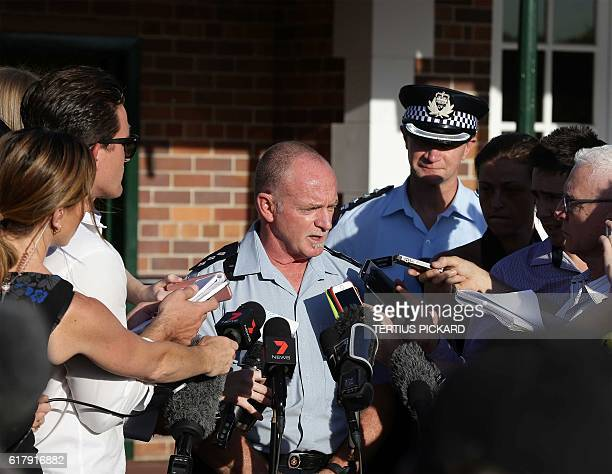 Queensland Ambulance spokesman Gavin Fuller briefs media at the Dreamworld theme park on Gold Coast on October 25 after four people were killed when...