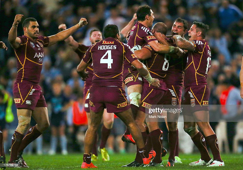 Queensland celebrate winning game three of the ARL State of Origin series between the New South Wales Blues and the Queensland Maroons at ANZ Stadium on July 17, 2013 in Sydney, Australia.
