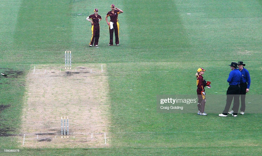 Queensland Fire captain Jodie Fields talks with umpires after they called a halt to play due to the weather during the WNCL Final match between the NSW Breakers and the Queensland Fire at the Sydney Cricket Ground on January 13, 2013 in Sydney, Australia.