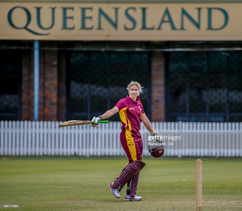 Queensland Fire Delissa Kimmince celebrates getting a century during the round one WNCL match between Queensland and ACT at Allan Border Field on...