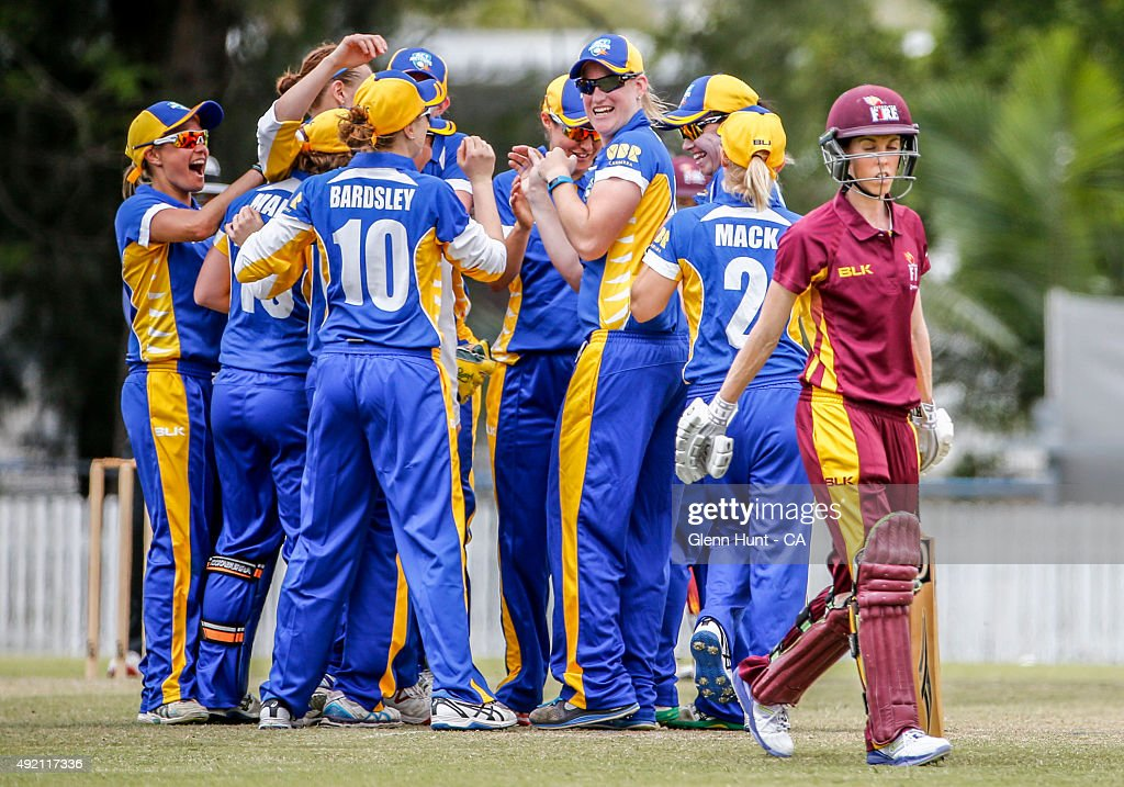 Queensland Fire Kirby Short leaves the field after being caugtht by ACT Lea Tahuhu during the round one WNCL match between Queensland and ACT at...