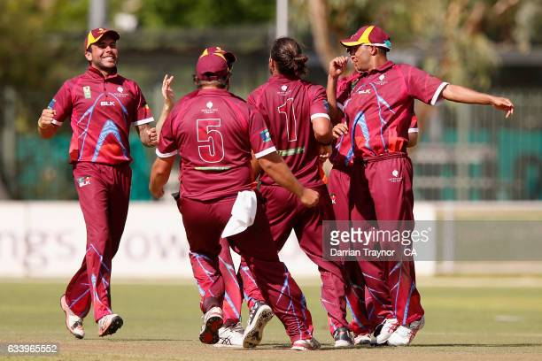Queensland players celebrate a wicket during the National Indigenous Cricket Championships match between News South Wales and Queensland on February...