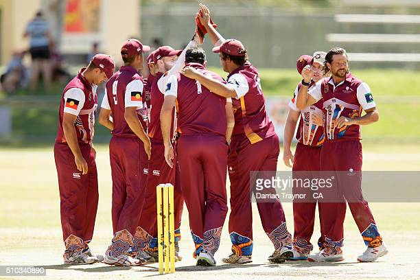 Queensland players celebrate the wicket of Damien Duroux of New South Wales during the National Indigenous Cricket Championships final on February 15...