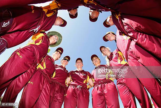 Queensland players form a huddle at the start of play during the WNCL match between Queensland and Tasmania at Allan Border Field on October 13 2016...