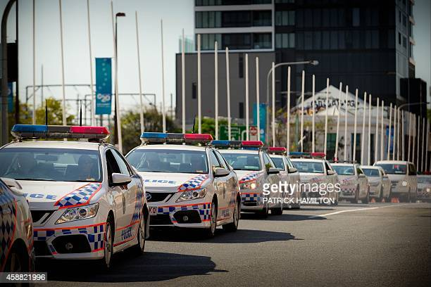 Queensland police cars queue at an entrance to the G20 Precinct near the Brisbane Exhibition and Convention Centre ahead of the G20 Summit in...