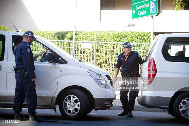 Queensland police check vehicles at an entrance to the G20 Precinct near the Brisbane Exhibition and Convention Centre ahead of the G20 Summit in...