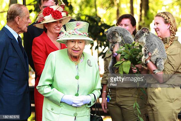 Queensland Premier Anna Bligh shows Queen Elizabeth II a koala during a visit to Rainforest Walk Southbank on October 24 2011 in Brisbane Australia...