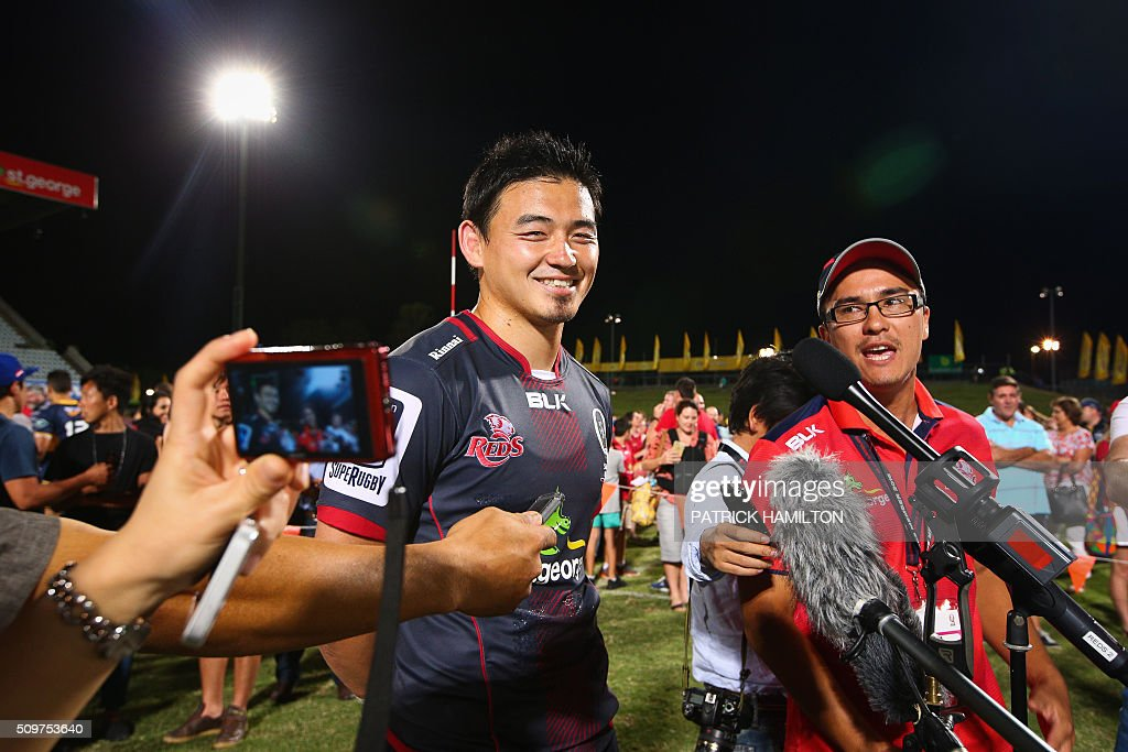 Queensland Reds Japanese import player Ayumu Goromaru (L) gestures during an infield press conference following the Super Rugby trial between Queensland Reds and Brumbies at Ballymore, Brisbane on February 12, 2016. The Super Rugby season starts on February 26. AFP PHOTO / PATRICK HAMILTON ---IMAGE RESTRICTED TO EDITORIAL USE - STRICTLY NO COMMERCIAL USE--- / AFP / PATRICK HAMILTON