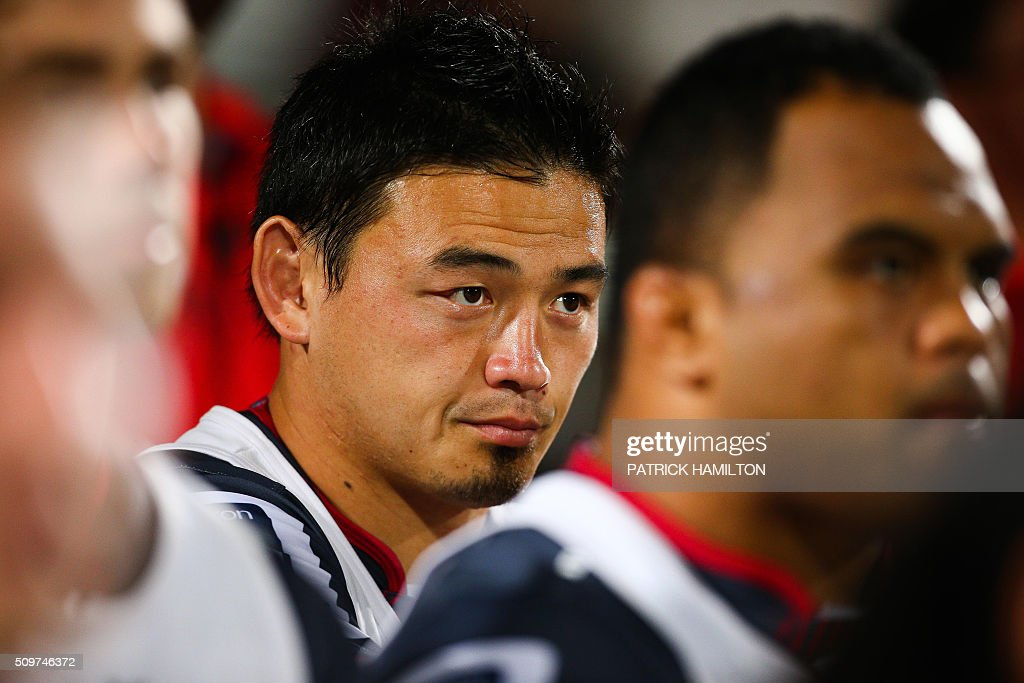 Queensland Reds Japanese import player Ayumu Goromaru looks on from the bench during the Super Rugby trial between Queensland Reds and Brumbies at Ballymore, Brisbane on February 12, 2016. The Super Rugby season starts on 26 February 2016. AFP PHOTO / PATRICK HAMILTON ---IMAGE RESTRICTED TO EDITORIAL USE - STRICTLY NO COMMERCIAL USE--- / AFP / PATRICK HAMILTON