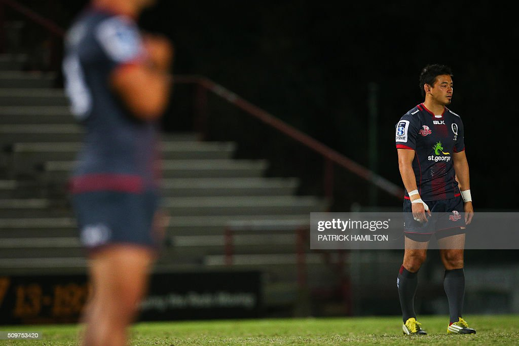 Queensland Reds Japanese import player Ayumu Goromaru (R) looks on on the field during the Super Rugby trial between Queensland Reds and Brumbies at Ballymore, Brisbane on February 12, 2016. The Super Rugby season starts on February 26. AFP PHOTO / PATRICK HAMILTON ---IMAGE RESTRICTED TO EDITORIAL USE - STRICTLY NO COMMERCIAL USE--- / AFP / PATRICK HAMILTON