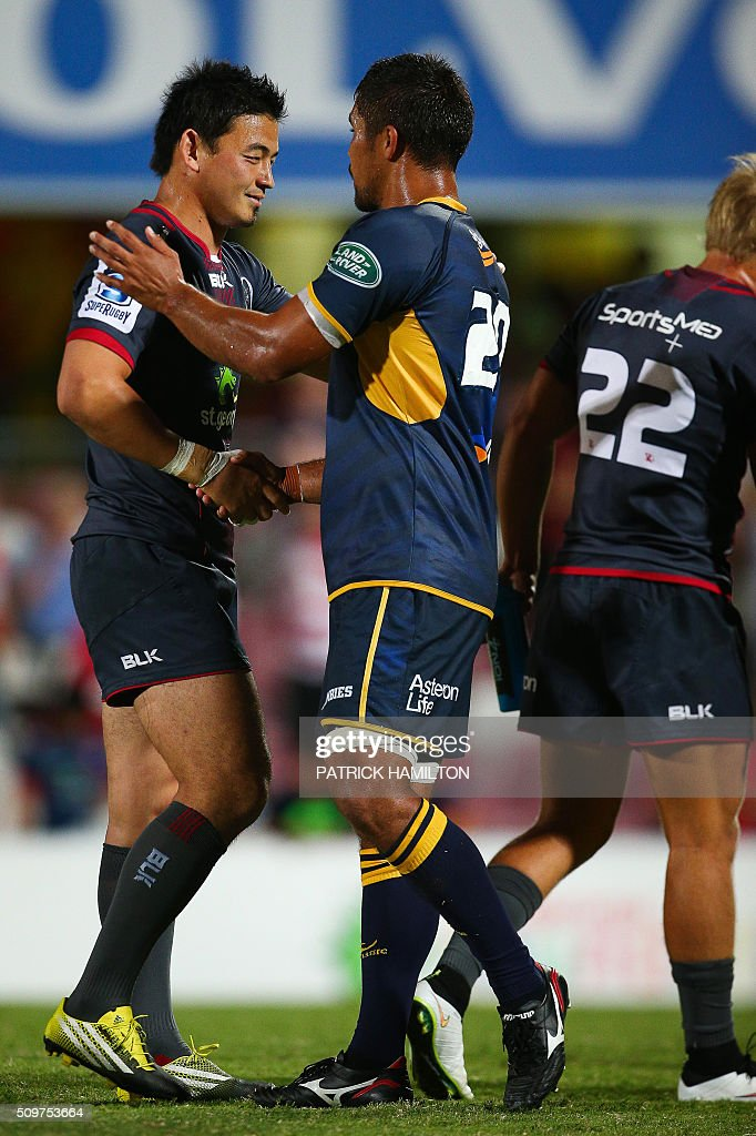 Queensland Reds Japanese import player Ayumu Goromaru (L) shakes hands with a player following the Super Rugby trial between Queensland Reds and Brumbies at Ballymore, Brisbane on February 12, 2016. The Super Rugby season starts on February 26. AFP PHOTO / PATRICK HAMILTON ---IMAGE RESTRICTED TO EDITORIAL USE - STRICTLY NO COMMERCIAL USE--- / AFP / PATRICK HAMILTON