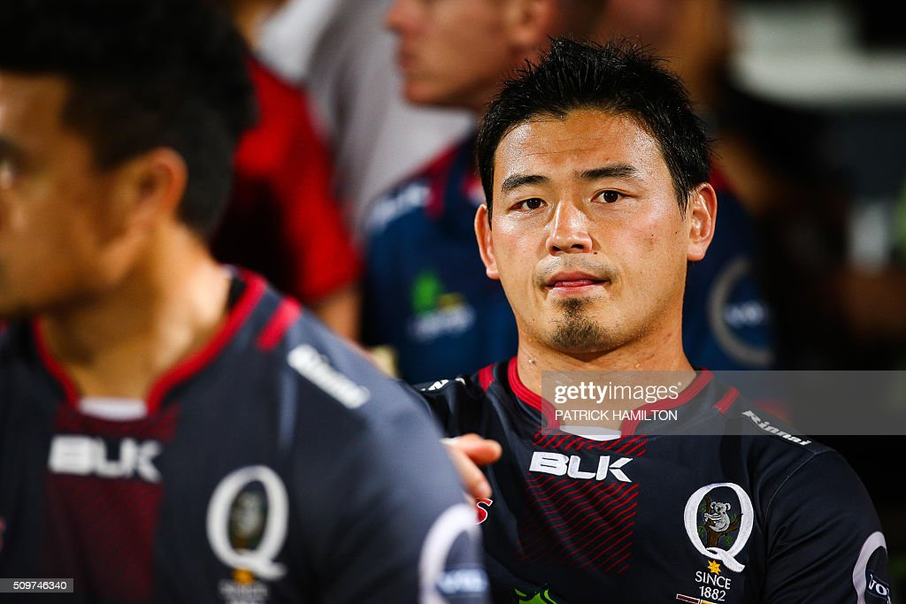 Queensland Reds Japanese import player Ayumu Goromaru waits on the bench during the Super Rugby trial between Queensland Reds and Brumbies at Ballymore, Brisbane on February 12, 2016. The Super Rugby season starts on 26 February 2016. AFP PHOTO / PATRICK HAMILTON ---IMAGE RESTRICTED TO EDITORIAL USE - STRICTLY NO COMMERCIAL USE--- / AFP / PATRICK HAMILTON