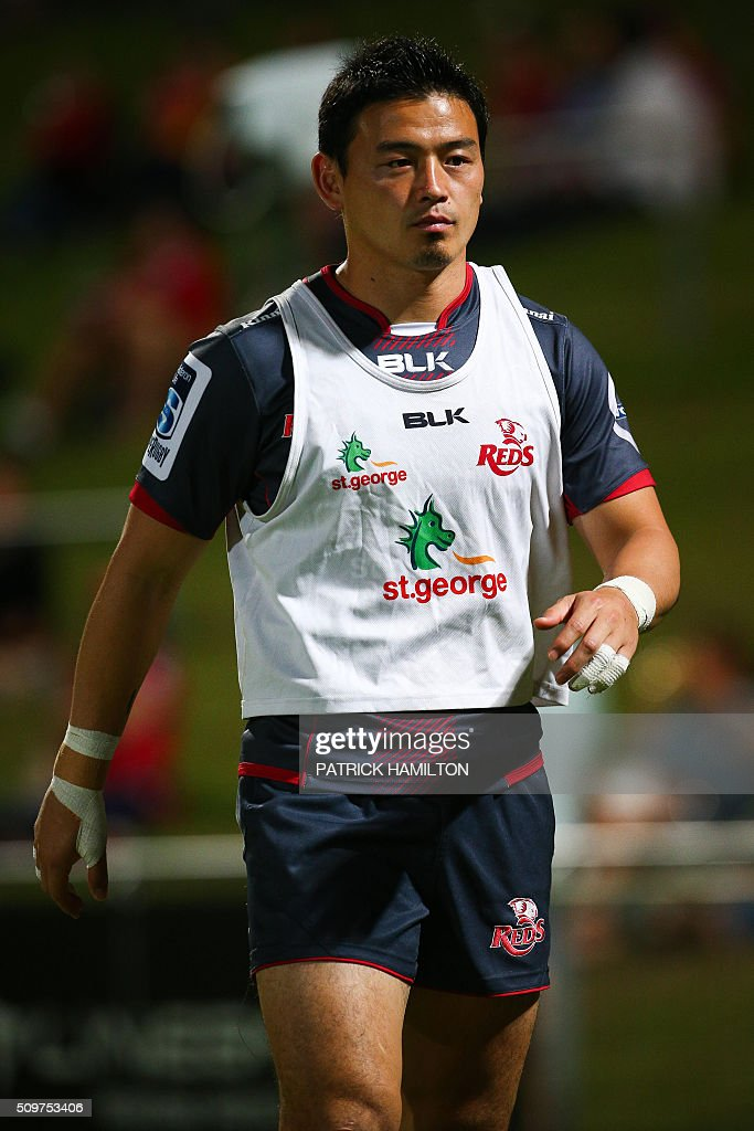 Queensland Reds Japanese import player Ayumu Goromaru warms up during the Super Rugby trial between Queensland Reds and Brumbies at Ballymore, Brisbane on February 12, 2016. The Super Rugby season starts on February 26. AFP PHOTO / PATRICK HAMILTON ---IMAGE RESTRICTED TO EDITORIAL USE - STRICTLY NO COMMERCIAL USE--- / AFP / PATRICK HAMILTON