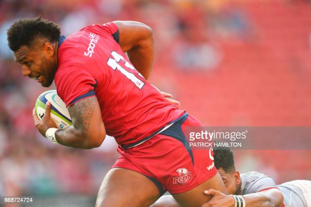 Queensland Reds' Samu Kerevi beats the tackle of Southern Kings' Yaw Pence during the Super Rugby match between the Queensland Reds and the Southern...