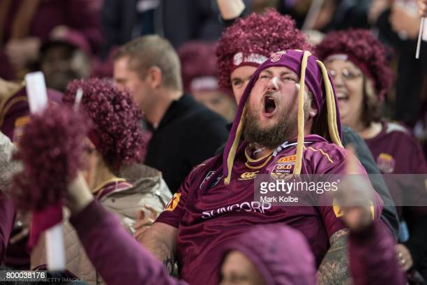 A queensland supporter in the crowd celebrates during game two of the State Of Origin series between the New South Wales Blues and the Queensland...