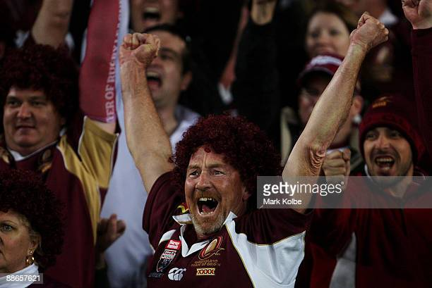 Queensland supporters in the crowd celebrate during game two of the ARL State of Origin series between the New South Wales Blues and the Queensland...