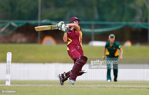 Queensland's Beth Mooney hits a six during the WNCL match between Queensland and Tasmania at Allan Border Field on October 13 2016 in Brisbane...