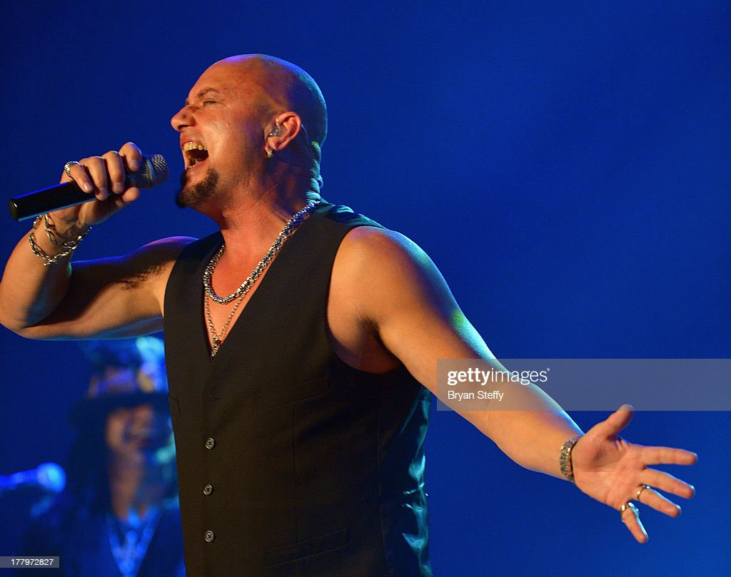 Queensryche singer <a gi-track='captionPersonalityLinkClicked' href=/galleries/search?phrase=Geoff+Tate&family=editorial&specificpeople=594895 ng-click='$event.stopPropagation()'>Geoff Tate</a> performs at the Vegas Rocks! Magazine Music Awards 2013 at the Joint inside the Hard Rock Hotel & Casino on August 25, 2013 in Las Vegas, Nevada.
