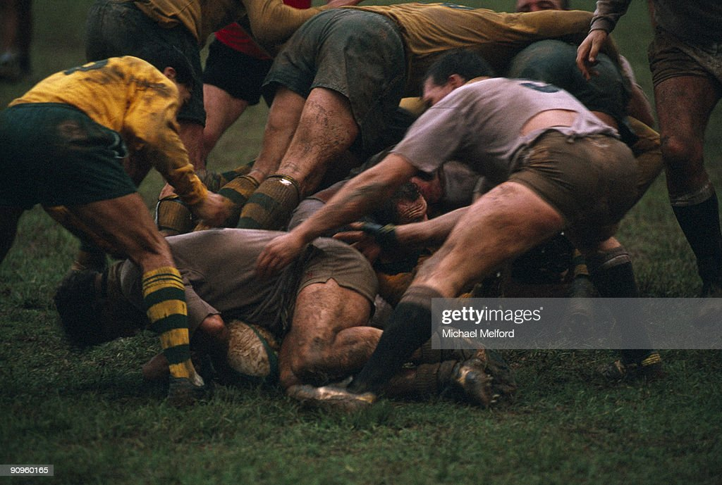 Rugby players fight for the ball.
