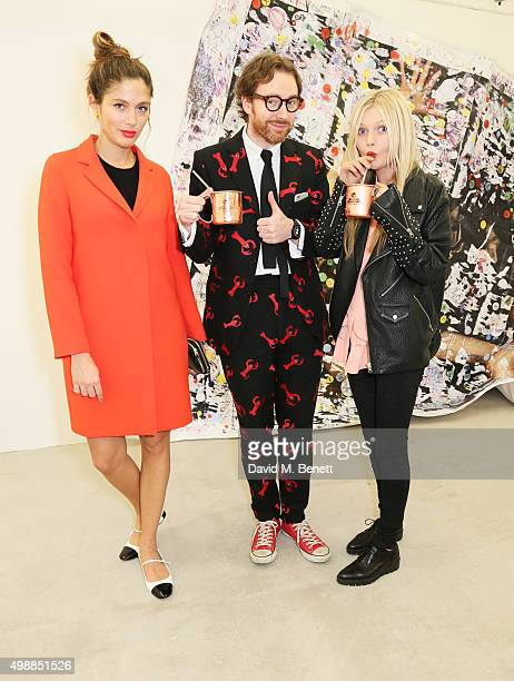 Quenin Jones Philip Colbert and Sophie Kennedy Clark attend the McQ Spitalfields launch on November 26 2015 in London England