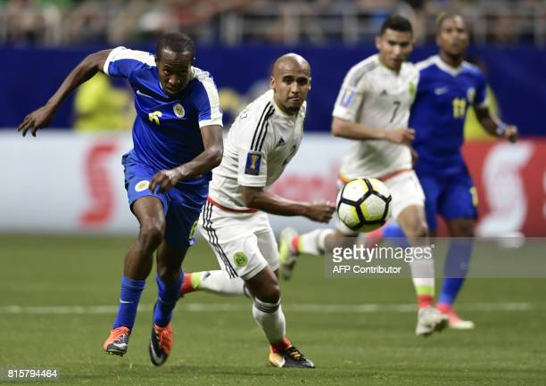 Quenten Martinus of Curacao and Luis Rodriguez of Mexico pursue to ball during their CONCACAF Gold Cup soccer match on July 16 2017 at the Alamodome...