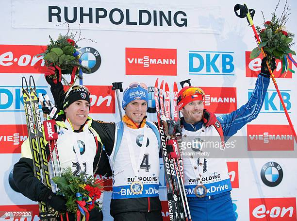 Quentin Fillon Maillet of France second place Simon Schempp of Germany first place and Michal Slesingr of the Czech Republic third place celebrate...