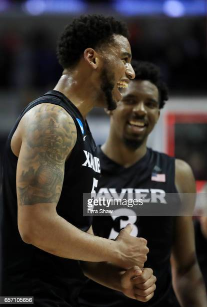 Quentin Goodin and Trevon Bluiett of the Xavier Musketeers of the Xavier Musketeers celebvrates their 73 to 71 win over the Arizona Wildcats during...