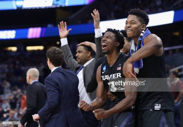 Quentin Goodin and Tyrique Jones of the Xavier Musketeers celebrate their 9166 over the Florida State Seminoles to advance during the second round of...