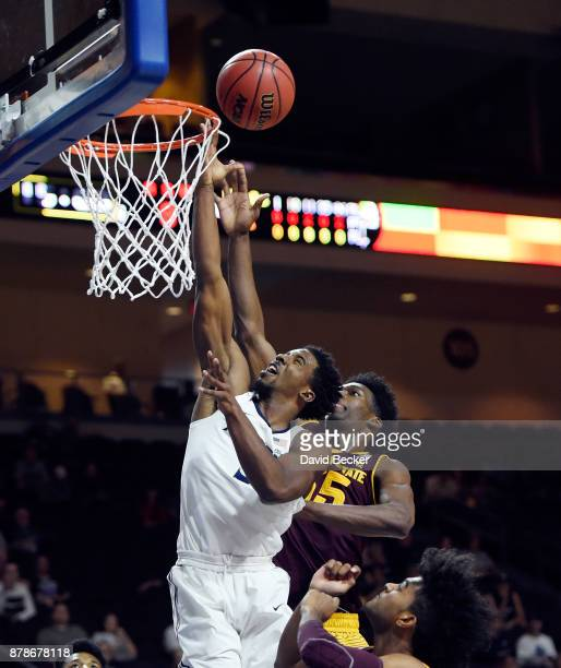 Quentin Goodin of the Xavier Musketeers shoots aginst De'Quon Lake of the Arizona State Sun Devils during the championship game of the 2017...
