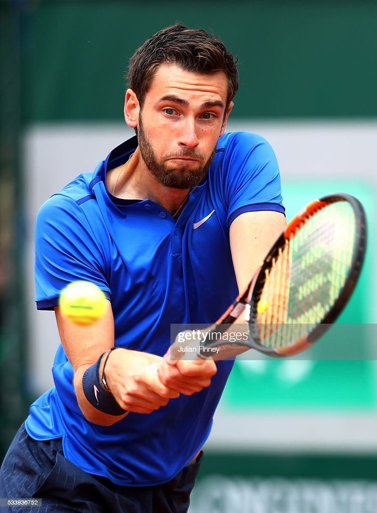 Quentin Halys of France plays a backhand during the Men's Singles first round match against Hyeon Chung of Korea on day three of the 2016 French Open at Roland Garros on May 24, 2016 in Paris, France.