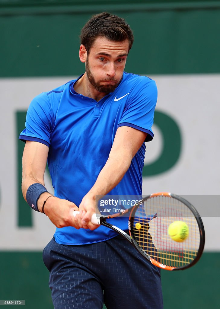 <a gi-track='captionPersonalityLinkClicked' href=/galleries/search?phrase=Quentin+Halys&family=editorial&specificpeople=9450477 ng-click='$event.stopPropagation()'>Quentin Halys</a> of France plays a backhand during the Men's Singles first round match against Hyeon Chung of Korea on day three of the 2016 French Open at Roland Garros on May 24, 2016 in Paris, France.