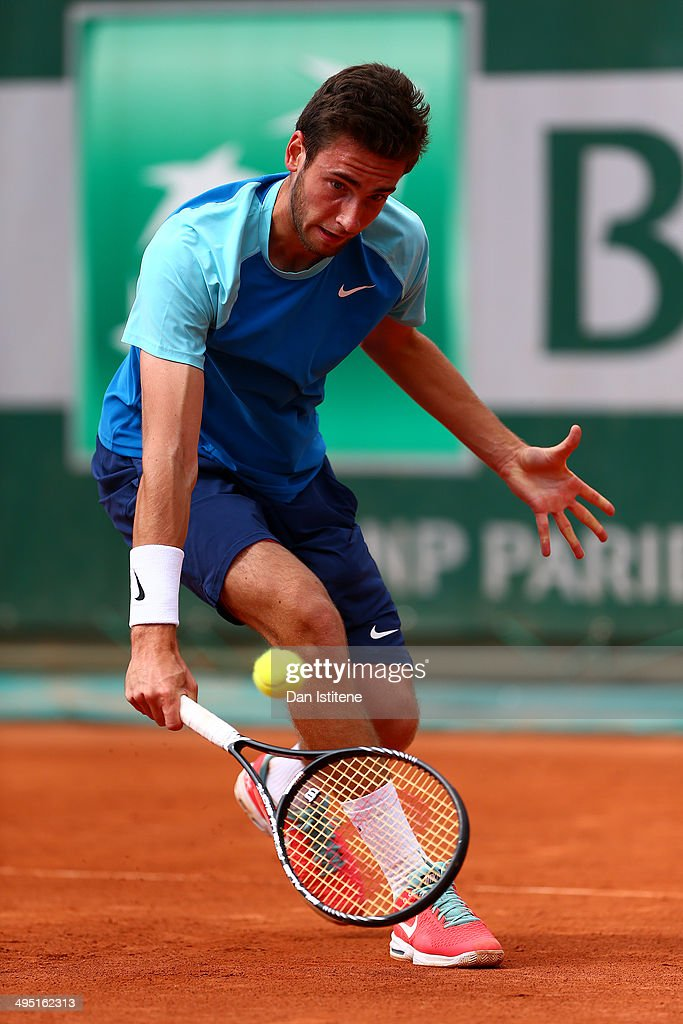 <a gi-track='captionPersonalityLinkClicked' href=/galleries/search?phrase=Quentin+Halys&family=editorial&specificpeople=9450477 ng-click='$event.stopPropagation()'>Quentin Halys</a> of France returns a shot during his boys' singles match against Nicolae Frunza of Romania on day eight of the French Open at Roland Garros on June 1, 2014 in Paris, France.