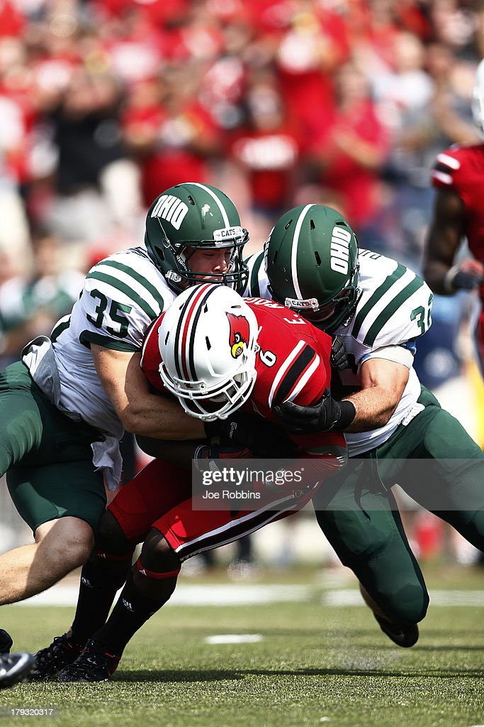 Quentin Poling #32 and Nathan Carpenter #35 of the Ohio Bobcats make a tackle against Eli Rogers #6 of the Louisville Cardinals during the game at Papa John's Cardinal Stadium on September 1, 2013 in Louisville, Kentucky. Louisville won 49-7.