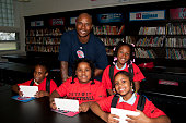 Quentin Richardson of the Detroit Pistons poses with students as they renovate a library as part of the NBA's Live Learn and Play Program event on...